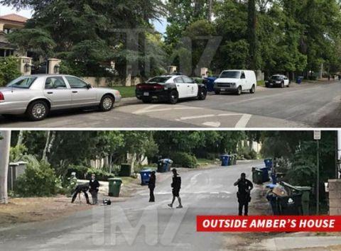 0517-cops-outside-ambers-home-tmz-wm-3